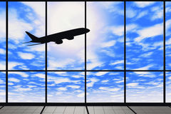 Airport windows with flying airplane Royalty Free Stock Image