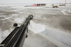 Airport in winter. Deicing of the airplane Stock Image