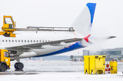 Airport in winter Deicing of the airplane departire.  Stock Images
