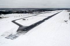 Airport and winter runway, view from a height to a snow-covered landscape. Airport and winter runway, view from a height to a snow-covered landscape stock photography