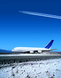 Airport in winter time. Airport and the big plane in winter time Stock Images