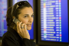 Airport Woman with cellphone royalty free stock image