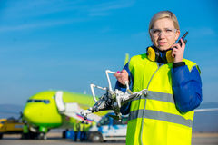 Airport worker with crashed drone Royalty Free Stock Photos