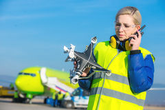 Airport worker with crashed drone Royalty Free Stock Image