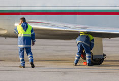Airport worker runway airplane Royalty Free Stock Photography