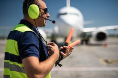 Airport worker using headset for speaking stock photos