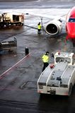 Airport workers getting the plane ready to take off in time. stock images