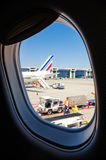 Airport workers at Malpensa italy. MILAN, ITALY - MAY 17, 2017: workers of Malpensa Airport Milan, Italy seen from an airplane window, on may 17, 2017 Royalty Free Stock Image
