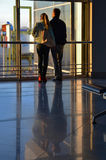 Airport. Young couple awaiting morning flight Stock Image
