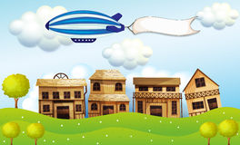 An airship above the neighborhood with a banner Stock Image
