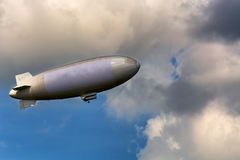 Airship for advertising and for sightseeing flights. Airship, zeppelin against blue sky with dark clouds Royalty Free Stock Photos