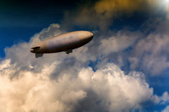 Airship for advertising and for sightseeing flights. Airship, zeppelin against blue sky with dark clouds Stock Photography