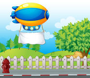 An airship with a banner near the road Royalty Free Stock Image