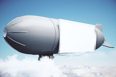 Airship with banner Stock Photo