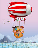 An airship carrying kids Royalty Free Stock Image
