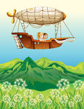 An airship carrying two young girls Stock Images