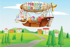 An airship with colorful eggs and two bunnies Stock Photo