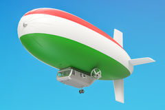 Airship or dirigible balloon with Hungarian flag, 3D rendering. Airship or dirigible balloon with Hungarian flag, 3D Royalty Free Stock Photography