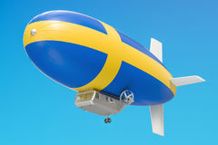 Airship or dirigible balloon with Swedish flag, 3D rendering. Airship or dirigible balloon with Swedish flag, 3D Stock Images