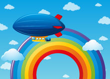 Airship flying over the rainbow Royalty Free Stock Photography