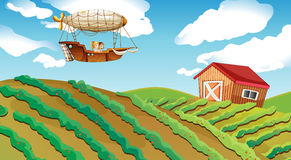 An airship passing over a farm. Illustration of an airship passing over a farm Stock Photo