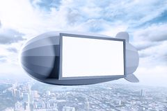 Airship. With poster over city Royalty Free Stock Image