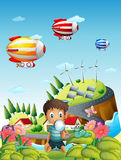 Airships, a village and a boy in the garden Royalty Free Stock Photography