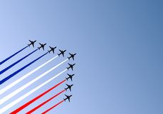 Airshow. Illustration of nine airplanes flying in formation and making a tricolor wake Stock Photos