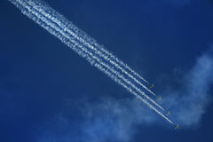 Airshow. Group of four airplanes making formation. UAE royalty free stock image