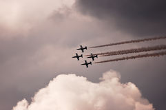 Airshow. Aircrafts leave traces on the sky during airshow royalty free stock image