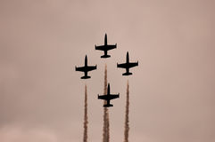 Airshow. Aircrafts leave traces on the sky during airshow royalty free stock images