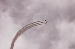 Airshow. Aircrafts leave traces on the sky during airshow stock image