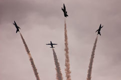 Airshow. Aircrafts leave traces on the sky during airshow stock photos