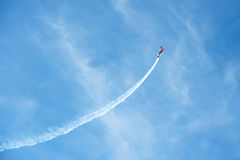 Airshow competition. Airplane during airshow looping acrobats Stock Photo