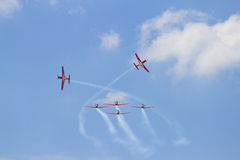 Airshow. Group of airplanes flying in airshow exhibition royalty free stock photography