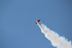 Airshow Louisville. Smoke follows a biplane doing stunts Royalty Free Stock Photography