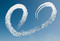 Airshow in love. Airshow with two planes make a heart of smoke Royalty Free Stock Photos
