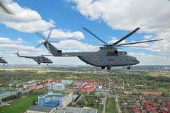 Airshow. MOSCOW, RUSSIA - MAY 05, 2015: Rehearsal of parade of the 70th anniversary of the Victory Day (WWII). A group of military helicopters the participants stock images