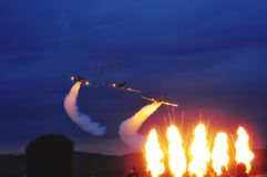 Airshow. Photography, sunset, sky, orange colour, outdoors, airplane, Sun, explosion, show royalty free stock image