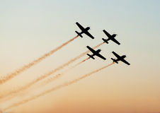 Airshow planes in formation. Airshow planes in star formation leaving smoke trails over sky Royalty Free Stock Photography