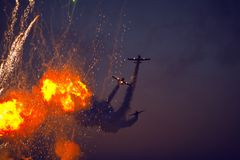 Airshow race and explosions Stock Photo