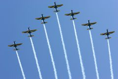 Airshow smoke trails. Airshow planes with smoke trails against a pristine blue sky stock photo