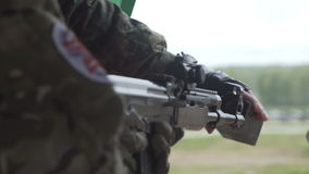 Airsoft game. Check shoot the ball from the Russian AK 47 airsoft drive stock video footage