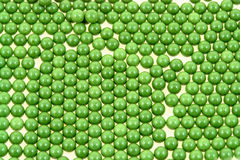 Airsoft green pellets. Airsoft 6mm green plastic pellets Stock Photo