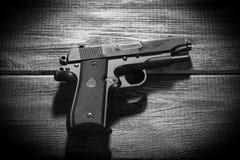 Airsoft gun replica on dark background Stock Photography