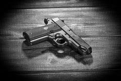 Airsoft gun replica on dark background Royalty Free Stock Photos