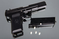 Airsoft gun set on a mirror Royalty Free Stock Images