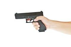 Airsoft Handgewehr, glock Baumuster mit der Hand lizenzfreie stockfotografie