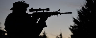Airsoft man silhouette at afternoon Stock Image