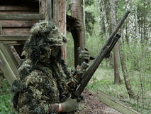 Airsoft player with Ghillie Suit. And sniper rifle Stock Images